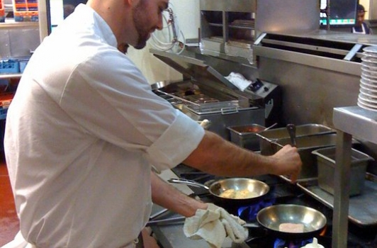 Sous Chef George searing off a nice piece of Wild Alaskan Halibut